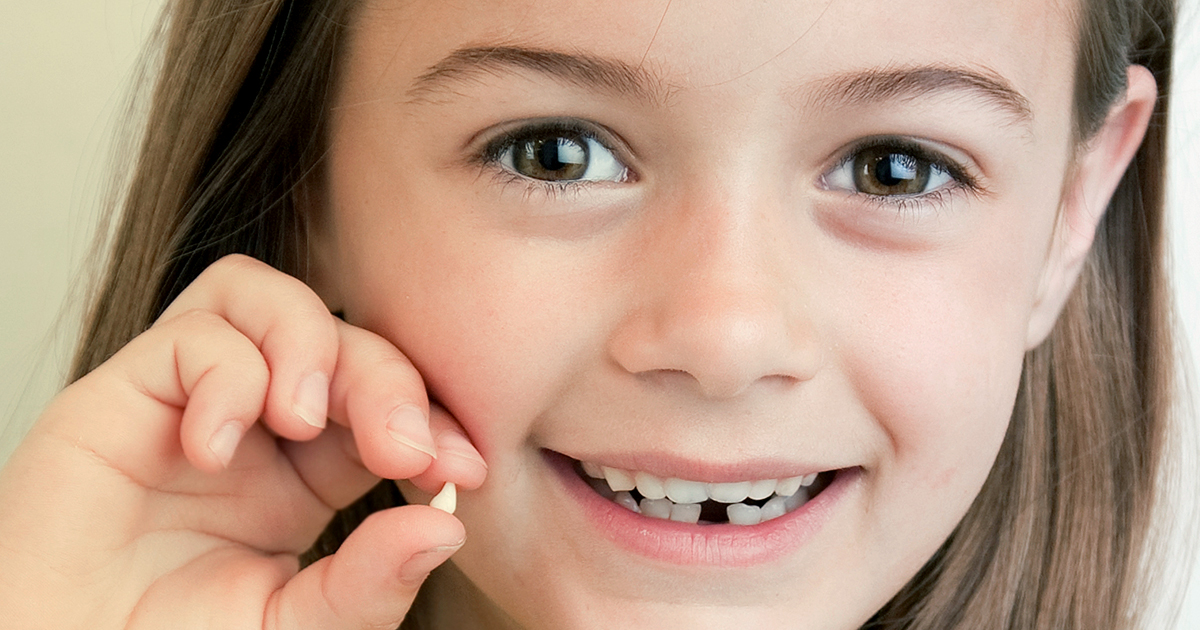 Как вырвать молочный зуб
